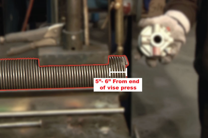 """Place the spring 5"""" to 6"""" from the end of the vise press."""